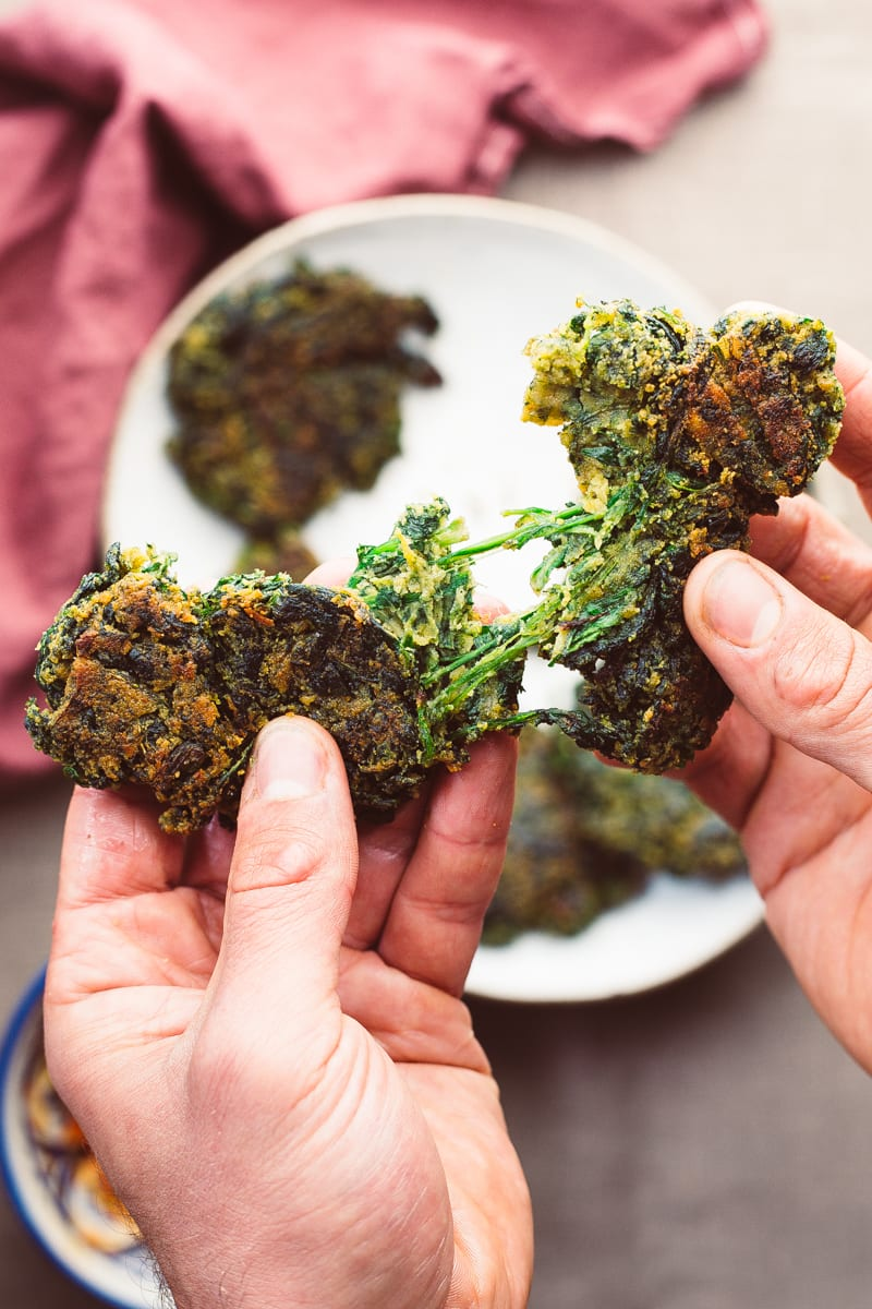spinach fritters hands tearing