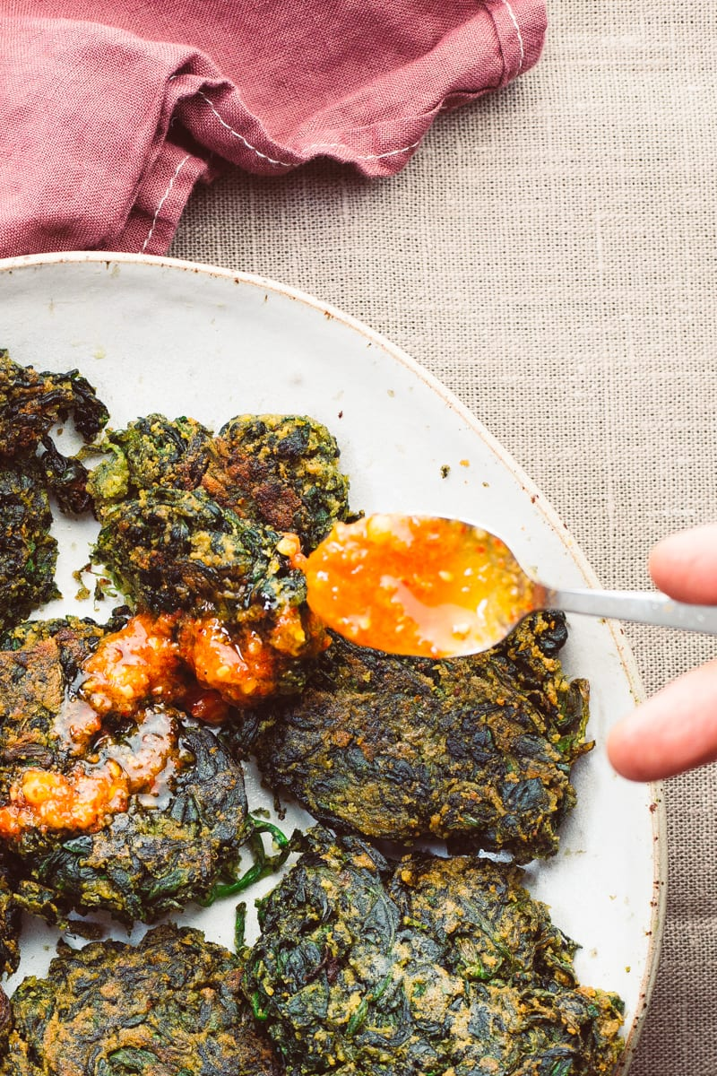 spinach fritters chilli oil drizzle