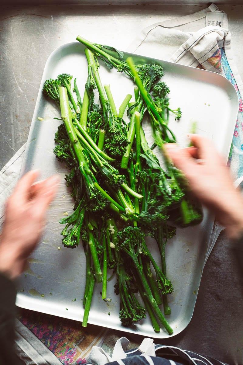 tossing tenderstem broccoli