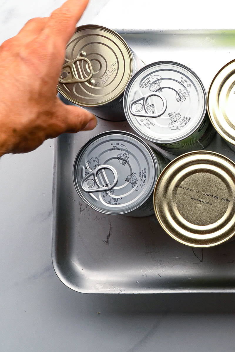 cans on top of tofu on a tray