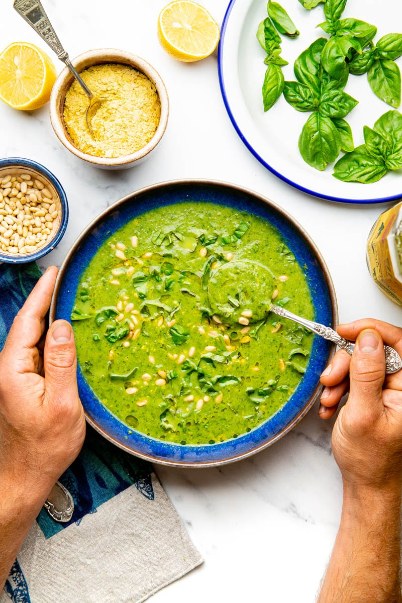 broccoli and spinach soup with persons hands