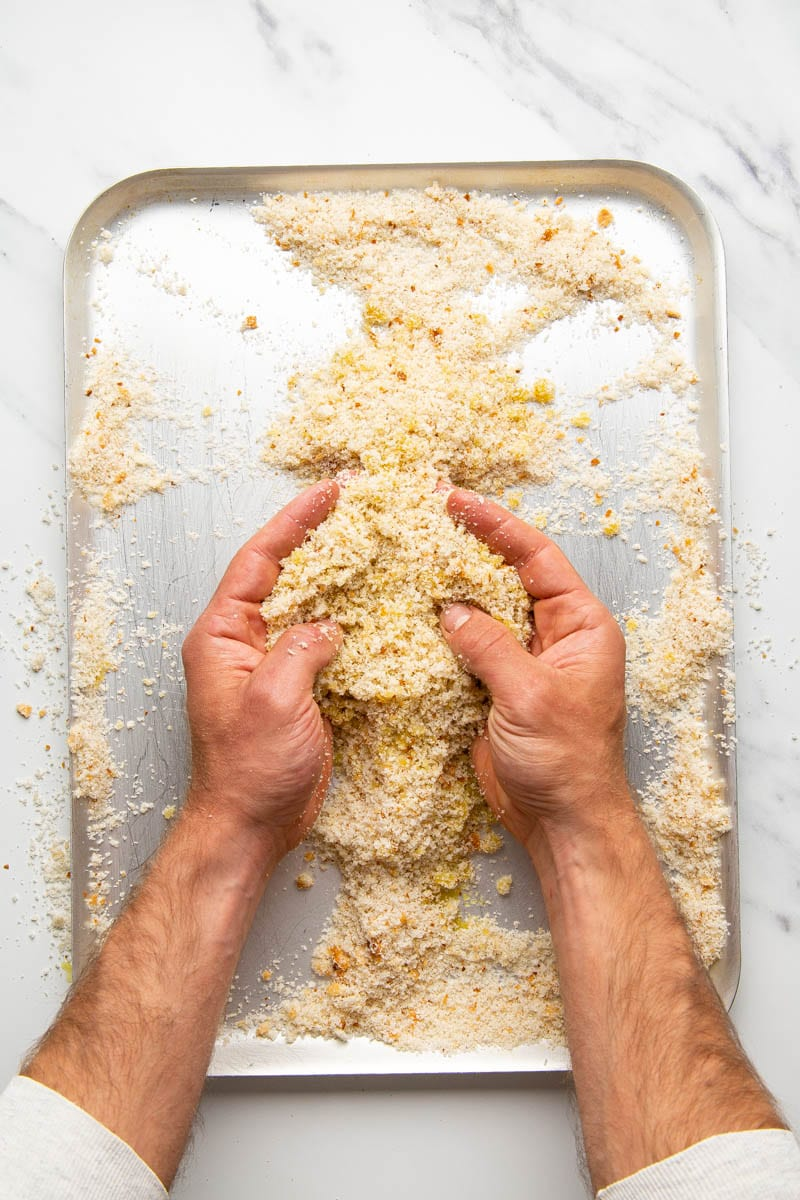 breadcrumbs with olive oil being tossed