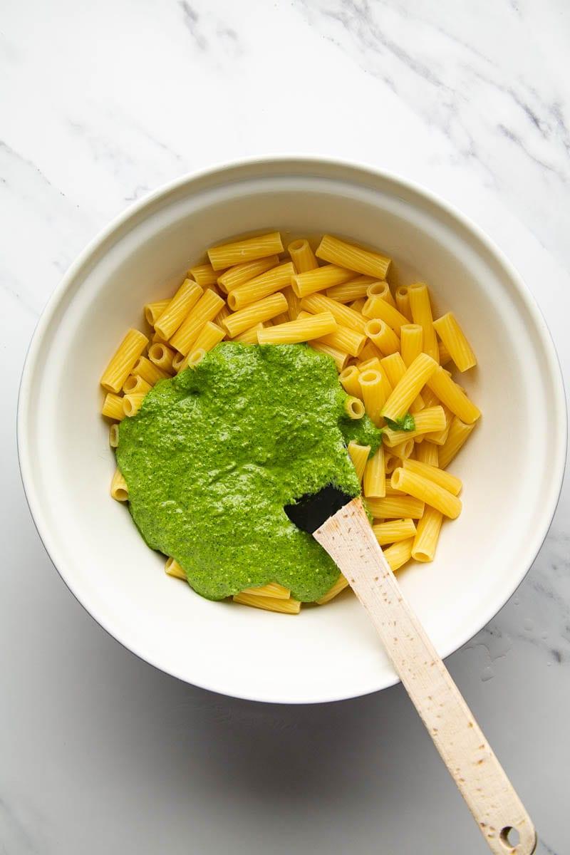 spinach pesto with rigatoni in bowl